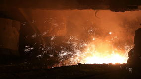 Smelting of liquid metal from blast furnace stock video