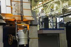 Smelting in a metallurgical plant. Molten metal spill Stock Photography