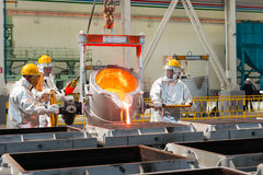Smelting in a metallurgical plant. Molten metal spill Stock Photo