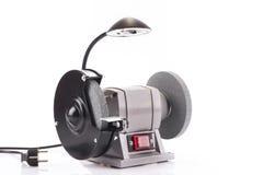 Smerigliatrice del banco con la lampada isolata su bianco Fotografie Stock