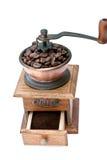 Smerigliatrice di caffè e chicchi di caffè Fotografia Stock