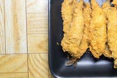 Smet stekt fisk i ägg Arkivfoton