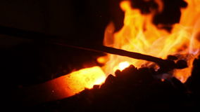 Smid Burning Flames in Forge stock footage