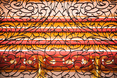 Smidesjärn i thai design Arkivbild