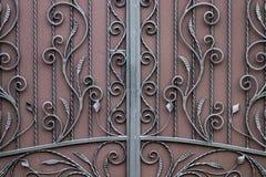 Smidesjärnportar, dekorativt smide, falsk beståndsdelnärbild royaltyfri fotografi