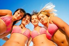 Smiilng bikini girls Stock Image