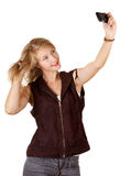 Smiing girl doing picture oneself Stock Images
