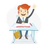 Smiingl school student raising up his hand at the desk on the le Stock Photography
