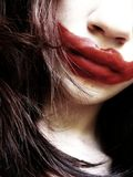 Smile. Girl with a clown make-up Royalty Free Stock Photo