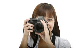 Smile!. A young woman taking a picture Stock Photos