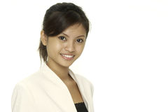 Smile. A smiling pretty asian woman in a white jacket Royalty Free Stock Images