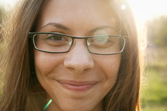 Smile. Girl with glasses. Beautiful young woman with smile. Good day Royalty Free Stock Image