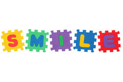 Smile. Word Smile, from letter puzzle, isolated on white background Royalty Free Stock Photos