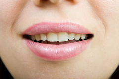 Smile. Of a young woman close Royalty Free Stock Photography