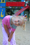 Smile. Young girl is having fun on the palyground Royalty Free Stock Photo