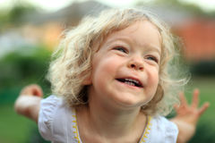 Smile. Smiling kid in summer park. Shallow depth of field royalty free stock images