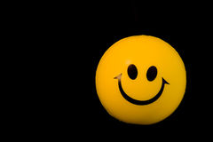 Smile. Yellow ball with smile face on it Royalty Free Stock Image