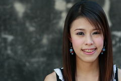 Smile. A portrait of an attractive young woman smiling Royalty Free Stock Photography