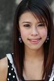 Smile. A young Asian teen smiles sweetly for the camera. She has braces Royalty Free Stock Photo
