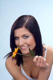 Smile. Happy woman with orange flower stock images