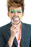 Smile!. Smiling asian freak with a magnifying glass Royalty Free Stock Image