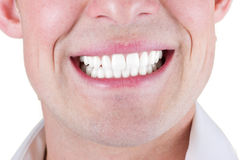 Smile. Adult male smile closeup isolated on a white background Stock Photos