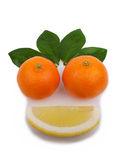 Smile. Happy face made with fresh fruits. Lemon and mandarin, isolated on a white background Royalty Free Stock Photos