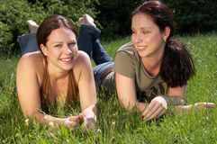 Smile. Two girls laying in the grass smiling Royalty Free Stock Photography