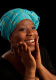 Smile from Africa. Attractive African girl wearing the traditional ghanese headdress scarf Stock Photos