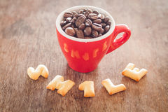 Smile alphabet biscuit with red coffee cup Stock Images