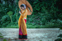 Smile ancient Thai Woman In Traditional Costume Of Thailand Stock Image