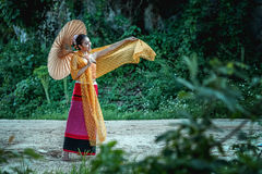 Smile ancient Thai Woman In Traditional Costume Of Thailand Royalty Free Stock Images