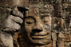 Smile. Angkor Thom, located in present day Cambodia, was the last and most enduring capital city of the Khmer empire. It was established in the late twelfth Royalty Free Stock Image