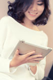 Smile asia woman sitting staircase using digital tablet computer Stock Images
