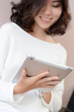 Smile asia woman sitting staircase using digital tablet computer Stock Photos