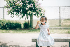 Smile asian baby girl play bubble balloon Royalty Free Stock Images