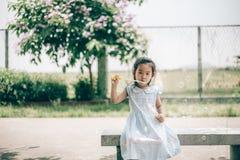 Smile asian baby girl play bubble balloon Stock Photos