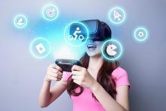 Girl playing game using VR stock image