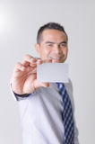 Smile asian business man showing business name card select focus Royalty Free Stock Photography