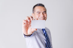 Smile asian business man showing business name card select focus Royalty Free Stock Image