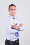 Smile asian business man showing money dollar with happiness Royalty Free Stock Image