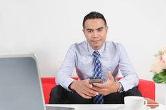 Smile asian business man using mobile smart phone Royalty Free Stock Photo