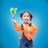 Smile Asian Engineer baby gir. L  with power saving bulb Stock Photo