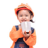 Smile Asian Engineer baby girl holding the white mug Royalty Free Stock Photo