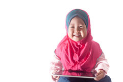 Smile Asian Girl toddler using tablet  with isolated background Royalty Free Stock Photography