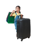 Smile Asian little girl holding shopping bag and luggage with ha. Ppiness isolated on white background with clipping path, concept for travel and shopping Royalty Free Stock Images
