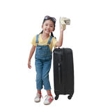 Smile Asian little girl showing dollar money nearly luggage with Royalty Free Stock Images