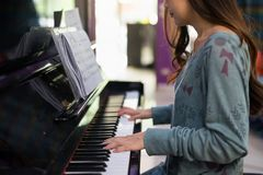 Happy woman play paino in house. Smile Asian woman pianist playing on classic Piano keyboard. Closeup fingers to music instruments. Happy leisure and hoppy in Royalty Free Stock Photography