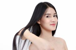 smile Asian woman touch her health long straight hair,beau royalty free stock photo