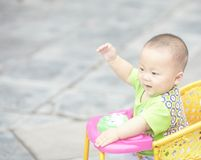 Smile baby boy. Seven month old baby boy in stroller on street Royalty Free Stock Images
